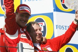 Podium: race winner Michael Schumacher celebrates with Jean Todt