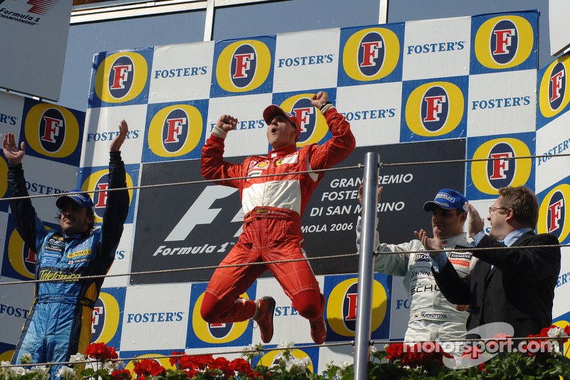 Podium: race winner Michael Schumacher with Fernando Alonso and Juan Pablo Montoya