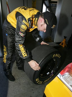 Matt Kenseth checks his tires