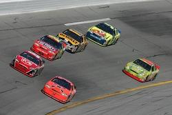 Jeff Burton leads a group of cars