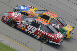 Carl Edwards races with Elliott Sadler for position