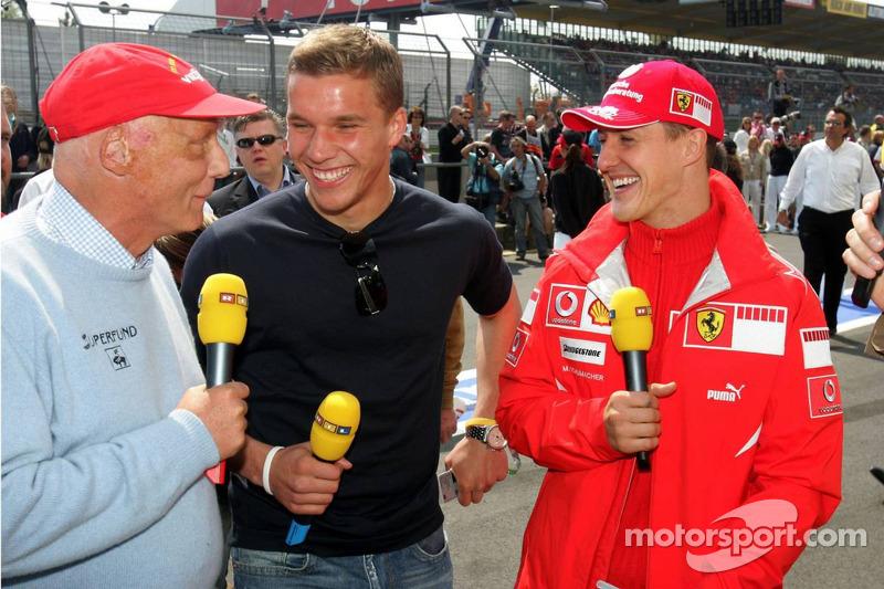 Niki Lauda, Lukas Podolski et Michael Schumacher