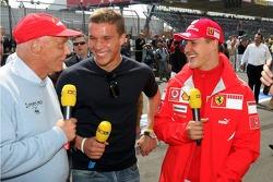 Niki Lauda, Lukas Podolski and Michael Schumacher