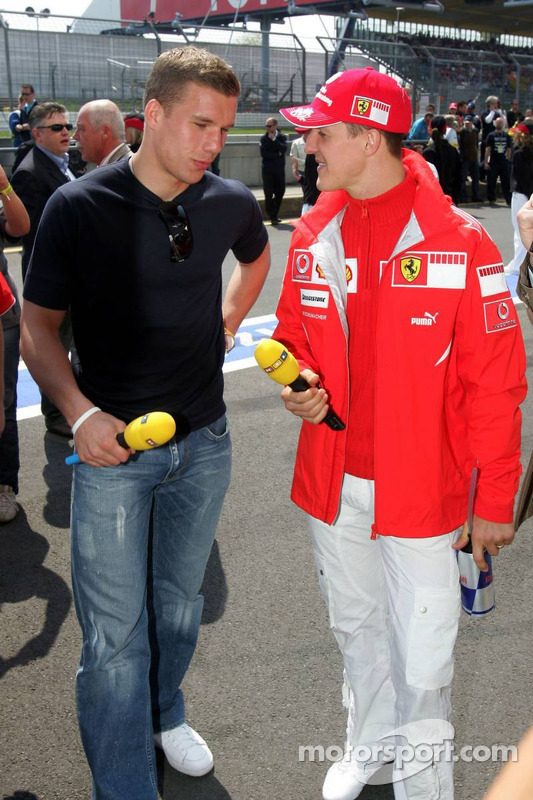 Lukas Podolski et Michael Schumacher