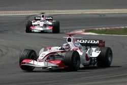 Takuma Sato leads Franck Montagny