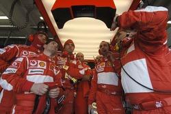 Ferrari team members watch qualifying
