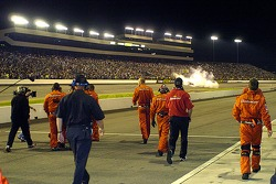 Dale Earnhardt Jr.'s crew heads towards Victory Lane while Dale does some doughnuts for the fans