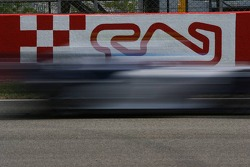 A car at speed at Circuit de Catalunya