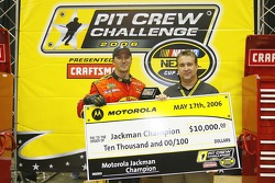 Jackman Champion Jeff Kerr receives a check for $10,000 after the NASCAR Nextel Pit Crew Challenge