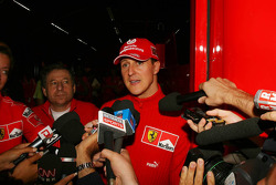 Michael Schumacher gives a press announcement at 9.42pm