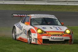 Mowing the grass in #92 Imsa Performance Matmut Porsche 996 GT3 RSR: Christophe Bouchut, Raymond Narac