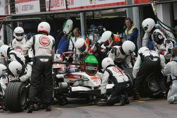 Rubens Barrichello makes a pitstop