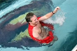 Sporting director Christian Horner in a Superman cape in the pool on the deck of the Red Bull Energy Station
