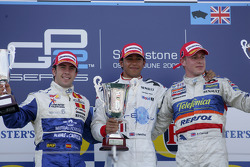 Podium: race winner Lewis Hamilton, second place, Felix Porteiro, third place, Adam Carroll