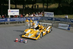 Miguel Amaral, Miguel Angel Castro, and Angel Burgueno pose with the Chamberlain - Synergy Motorsport Lola B06-10 AER