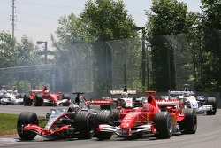 Juan Pablo Montoya and Michael Schumacher battle