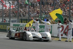#8 Audi Sport Team Joest Audi R10 takes the checkered flag