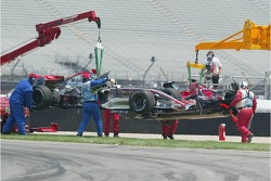 Cars of Kimi Raikkonen and Scott Speed are taken away after the crash at turn 1