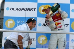 Podium: Mattias Ekström sprays champagne on Hans-Jurgen Abt