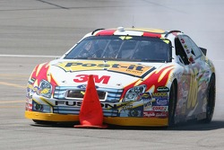 Todd Kluever has trouble with a  pitlane cone