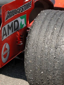 One of the rear tyres on the car of Michael Schumacher after the race