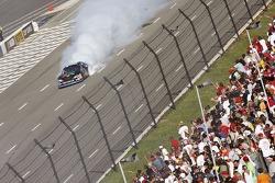Race winner Denny Hamlin celebrates with a burnout