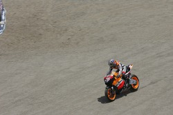 Dani Pedrosa takes a shortcut at the corkscrew