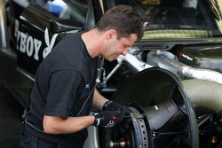 Mechanics work on the car of Christian Abt