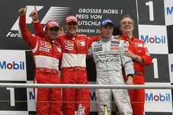 Podium: race winner Michael Schumacher with Felipe Massa, Kimi Raikkonen and Paolo Martinelli
