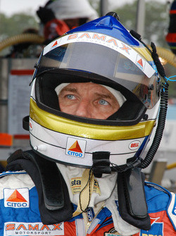 Stefan Johansson watches for his car on the big screen.