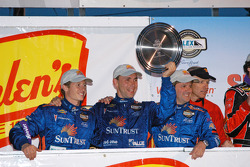 Ryan Briscoe, Max Angelelli and Wayne Taylor celebrate third