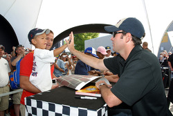 Jimmie Johnson and a young fan