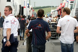 Team manager Jonathan Wheatley, David Coulthard and Robert Doornbos in the paddock