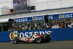 Race winner Jenson Button celebrates