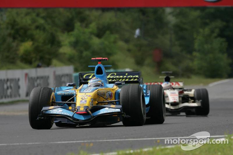 Fernando Alonso devant Rubens Barrichello