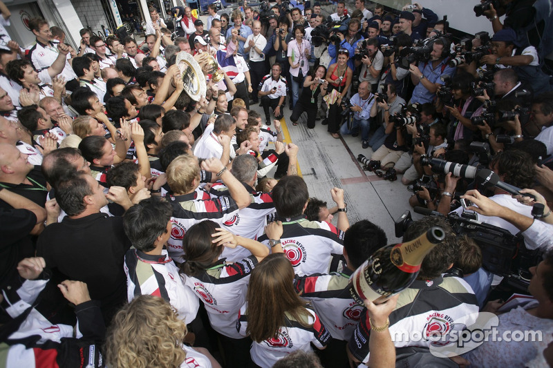 Race winner Jenson Button celebrates with Honda Racing F1 team members