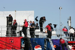 Crew members watch practice action from atop the transporters