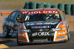 Rick Kelly being pressured by team mate Garth Tander