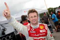 Pole winner Allan McNish celebrates
