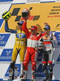 Podium: race winner Loris Capirossi with Valentino Rossi and Dani Pedrosa