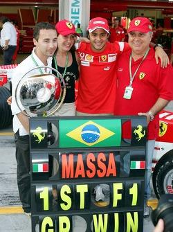 Race winner Felipe Massa celebrates with Nicolas Todt and his parents