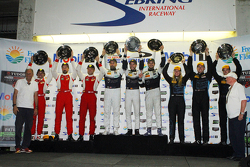 GTD class podium: winners Ian James, Mario Farnbacher, Alex Riberas, second place Bill Sweedler, Townsend Bell, Anthony Lazzaro, third place Brandon Davis, Christina Nielsen, James Davison