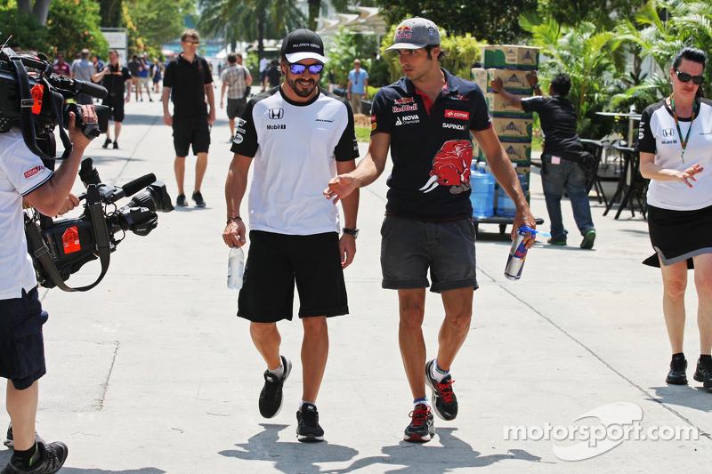 Fernando Alonso, McLaren with Carlos Sainz Jr. Scuderia Toro Rosso