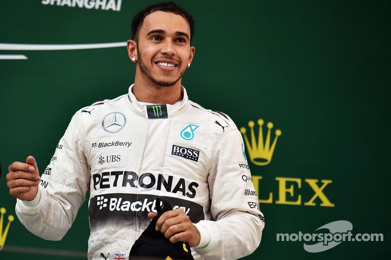 Race winner Lewis Hamilton Mercedes AMG F1 celebrates on the podium
