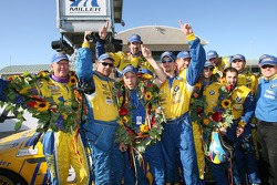 Race winners Anders Hainer and Boris Said celebrate with Turner Motorsport crew members