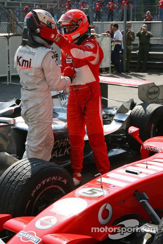 Race winner Michael Schumacher with Kimi Raikkonen