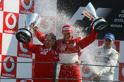 Podium: champagne shower for Michael Schumacher and Jean Todt