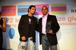 Lewis Hamilton receives the Overtaking Manouvre of the Year award from Tonio Liuzzi