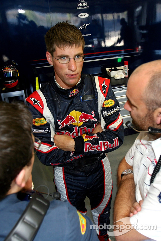 Michael Ammermueller with engineers in the garage