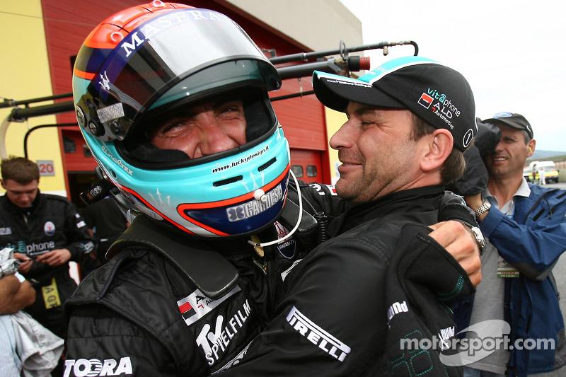 Pole winners Andrea Bertolini and Michael Bartels celebrate
